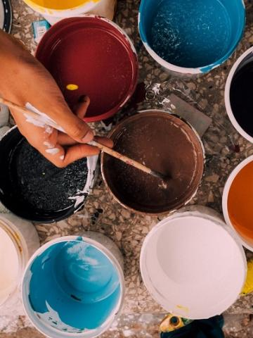 Photo of paint and brushes by Kelli Tungay